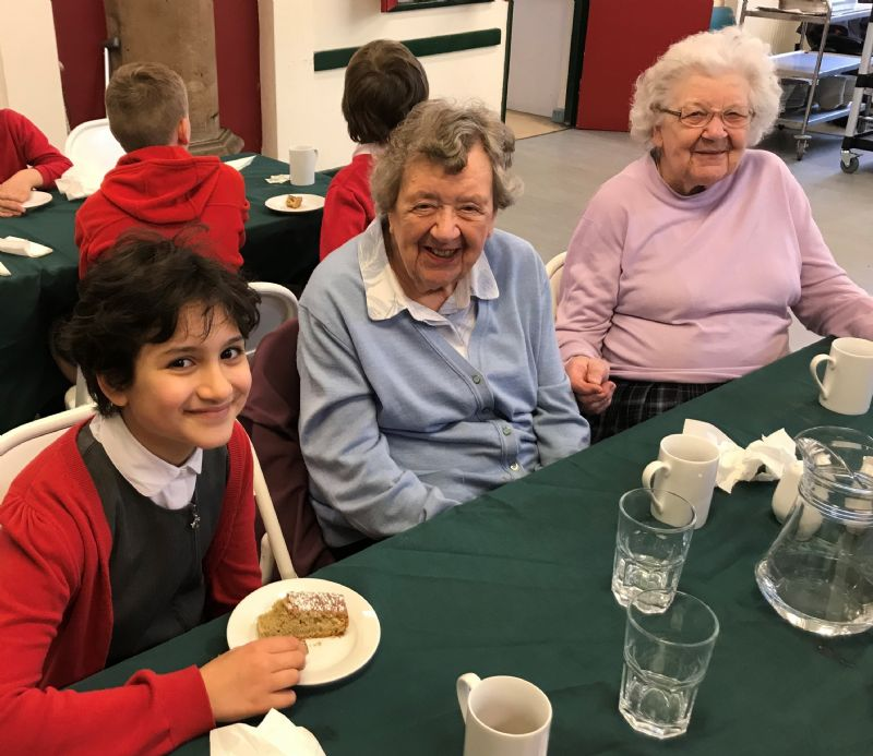 left to right (attached): 11 year-old Safa Ahmed from Chorlton Church of England Primary School joins Winifred Richards and Margaret Bell for lunch at the St Clement's Community Lunch Project.