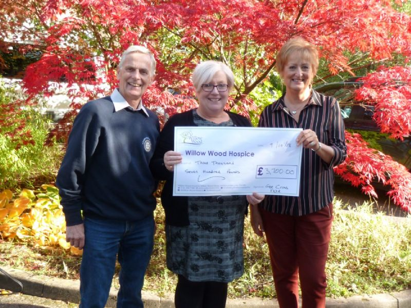 Pictured L to R Gee Cross Fete Chair Alan Oldham, Hyde Rotary President Karen Dorney Presenting the cheque to Elaine McConnell Event Community Fundraiser at The Hospice.
